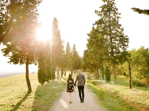 couple walks at sunset