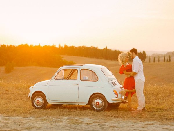 a kiss with the fiat in the background