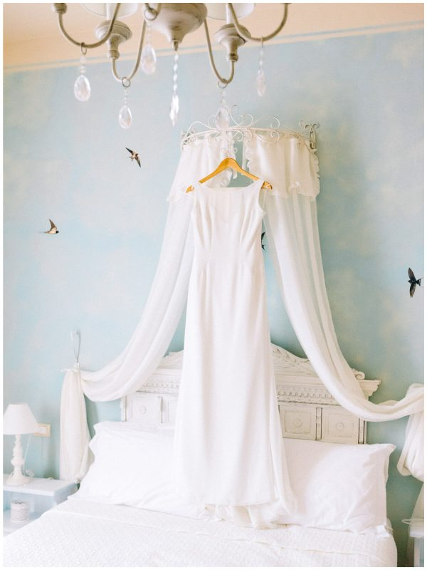 wedding gown hanged on the bed