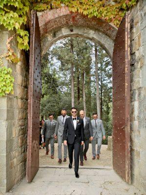 groom walking through the gate
