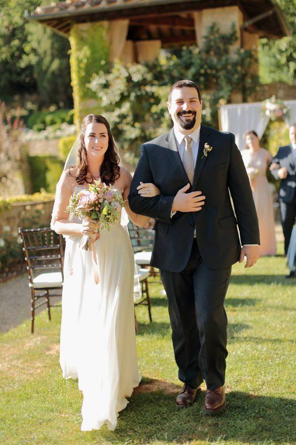 newlyweds walking down the aisle