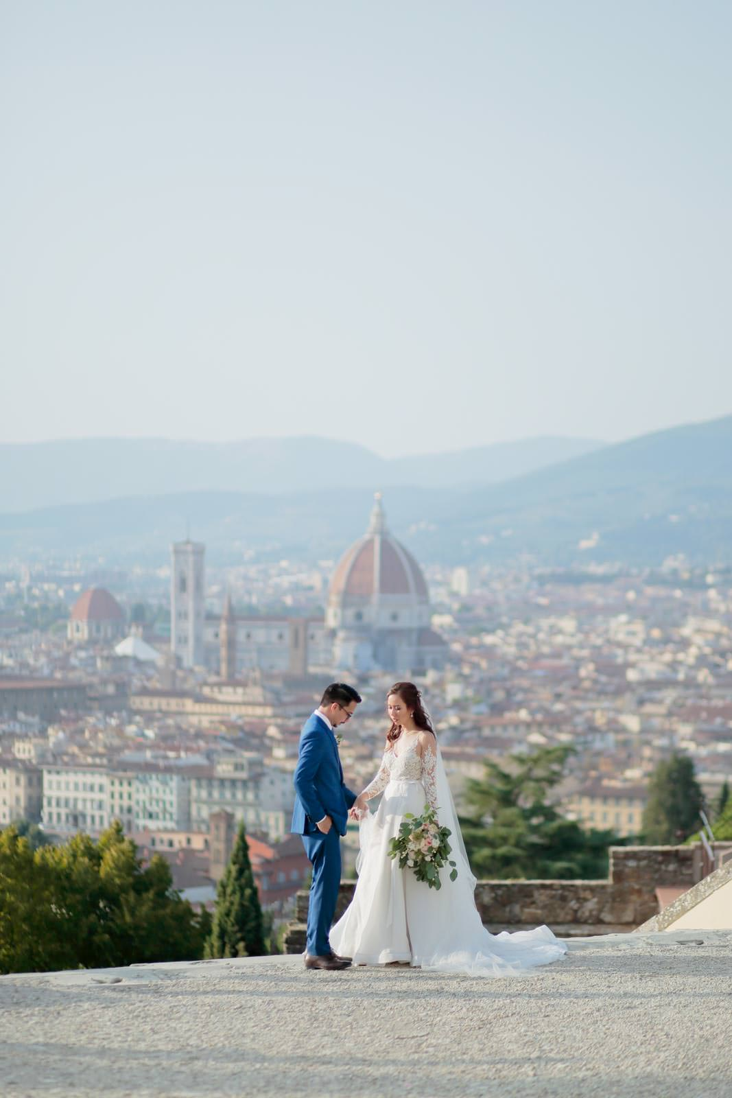 newlyweds strolling on a terrace with a view