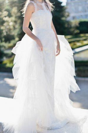 detail of a tot-hom bridal dress