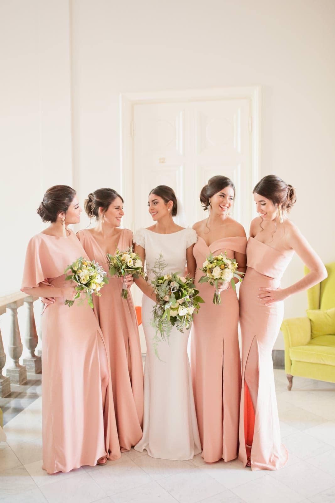 bride posing with the bridesmaids
