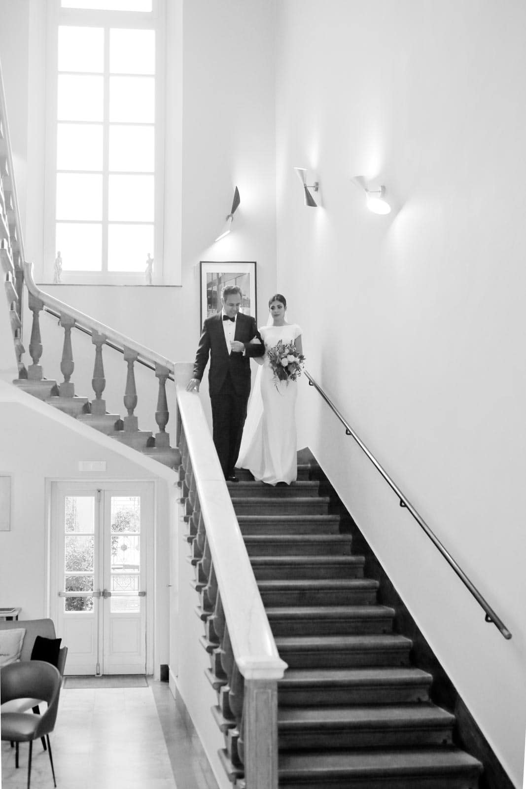 bride walking down the stair with her father
