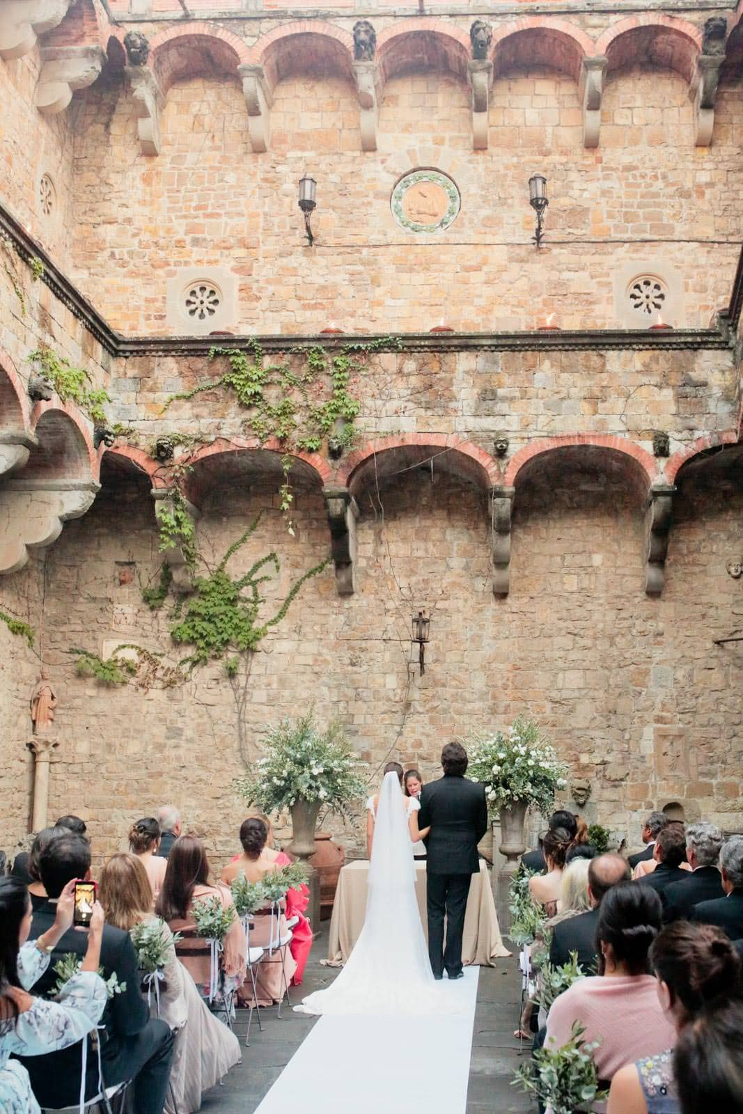 ceremony by the courtyard of castello di vincigliata
