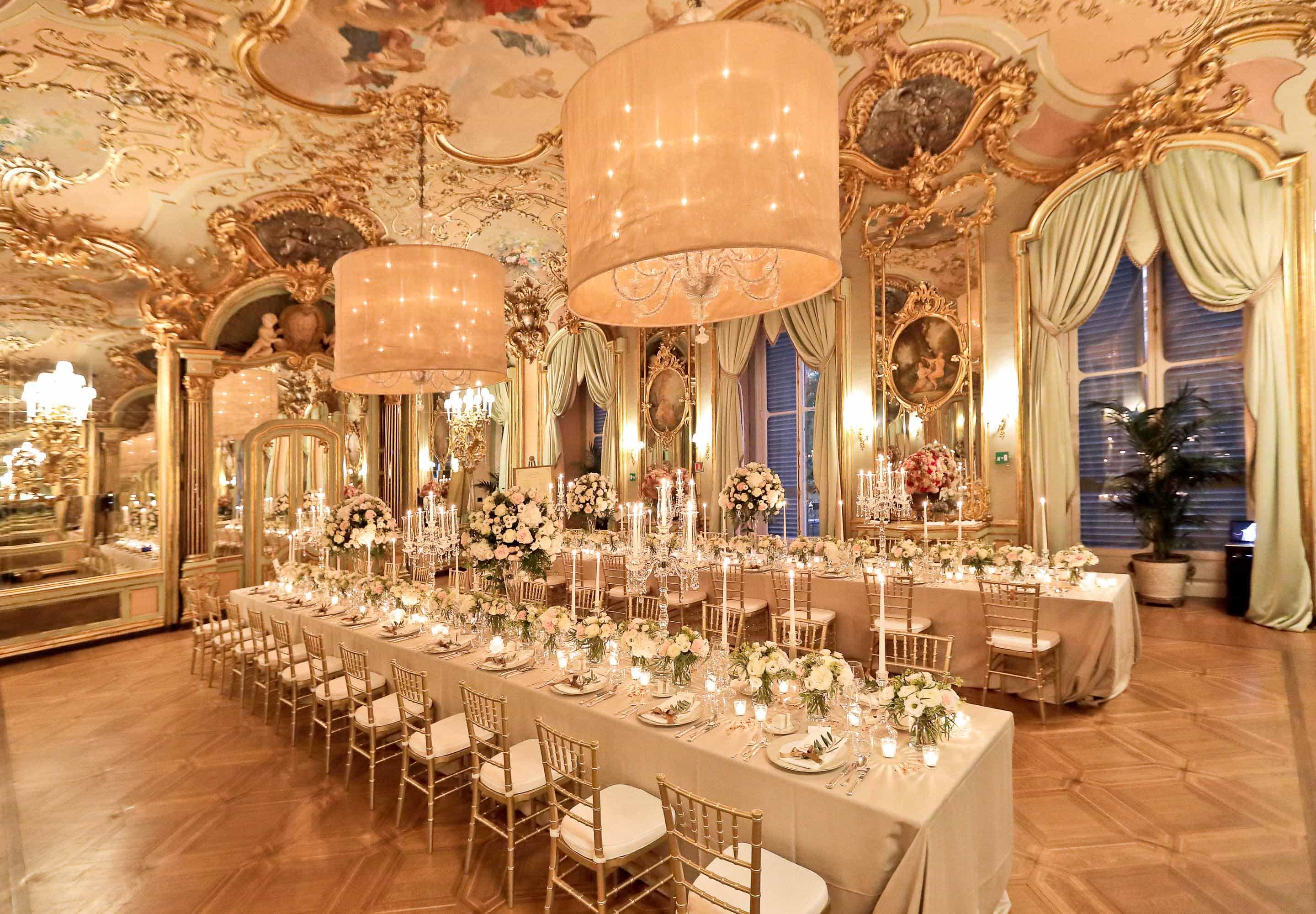 the mirror hall in villa cora set with a long table and candles before the wedding reception