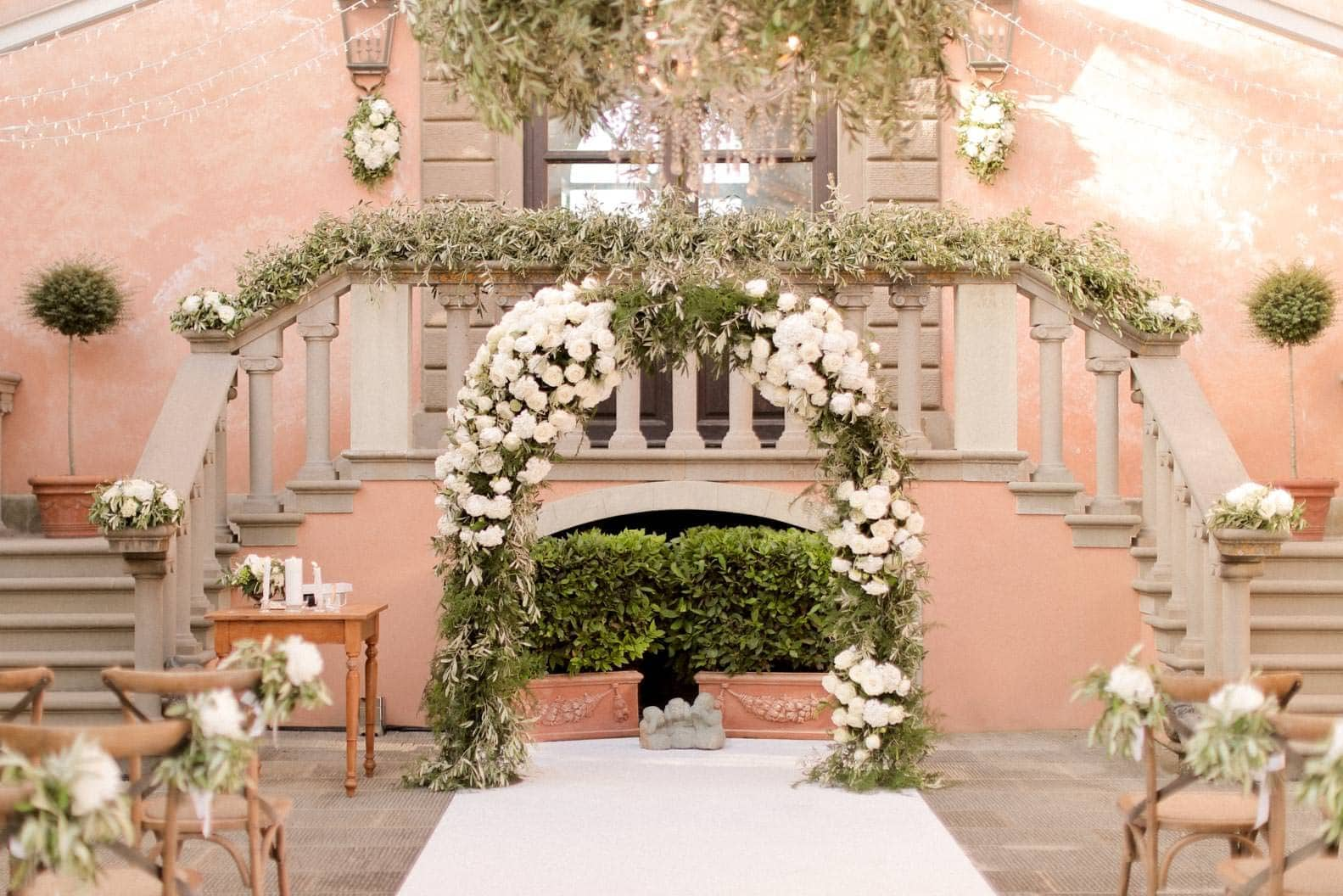 the flower arch and the decoration used for the ceremony setting