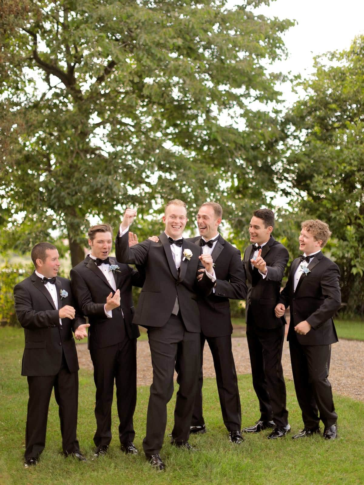 groomsmen having a great time in the garden
