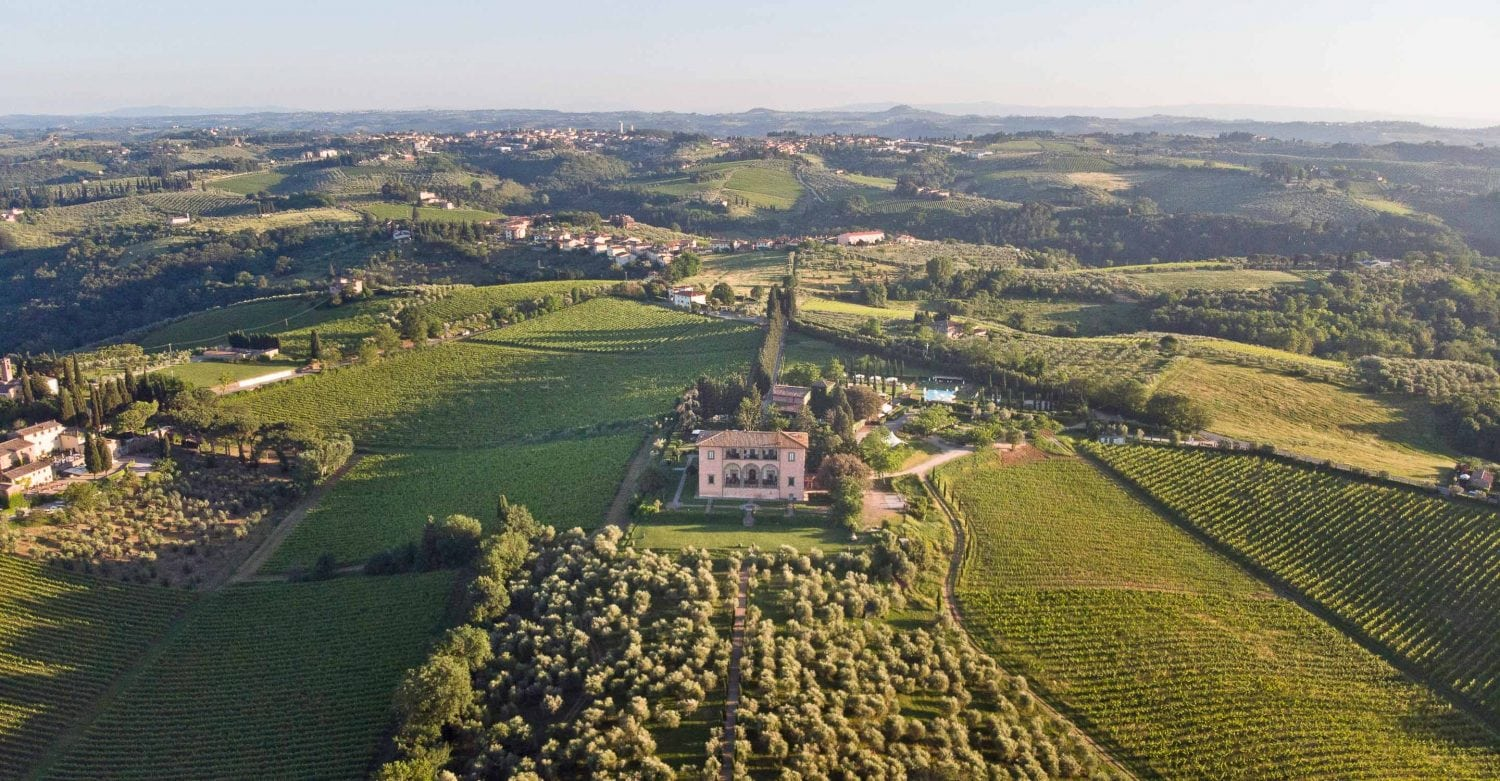Aerial view of villa mangiacane in tuscany surrounded by vineyards and the countryside