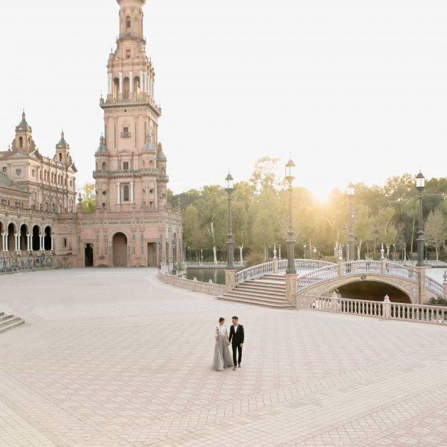 lovers strolling at sunset in the desert plaza de espana in seville spain