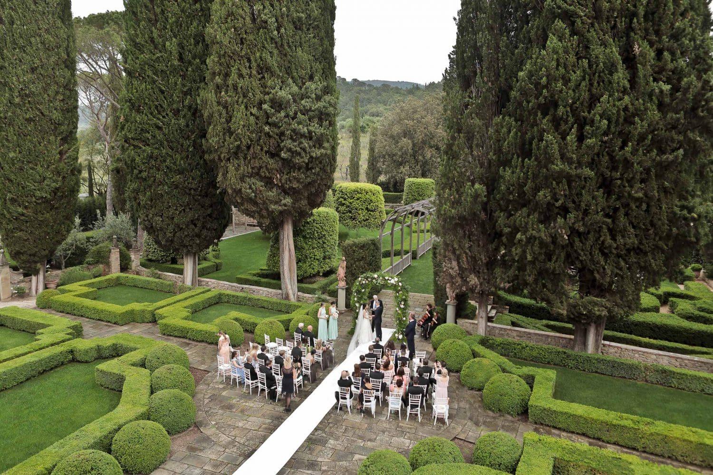 a moment from a garden ceremony at Villa Vignamaggio