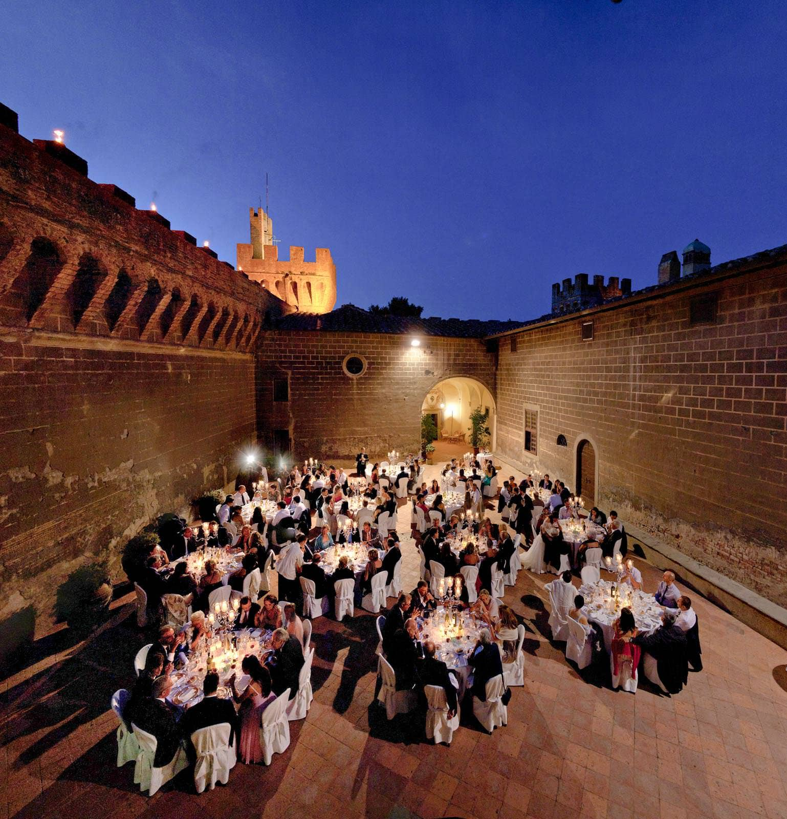 the courtyard of castello di oliveto at night